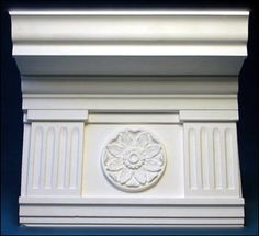 Georgian, 1720-1790.  Cornice molding with columns, plaster medallion with flower motif.    http://www.architecturalfx.com/images/3493.jpg#
