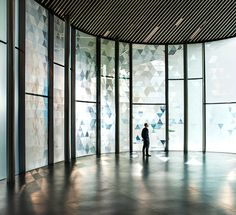 A responsive glass facade reacts to wind passing overs its surface, scattering triangular patterns of light and shadow in this installation at Now Gallery London by Dutch designer Simon Heijdens. Shade by Simon Keijdens at Now Gallery
