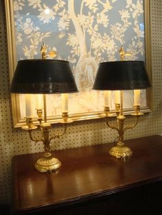 """A Fine PAIR of French Bouillotte Lamps, wired. Circa 1820. Beautiful Bronze Dore finish, with gilt lined Tole Shades. The Lamps are 13"""" in diameter and 23.75"""" to top of finial. In Excellent condition."""