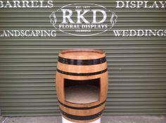 Wine Barrel with Shelve By RKD Floral Displays Barrels For Sale, Outdoor Flowers, Guinness, Baking Ingredients, Deco, Wedding Flowers, Whiskey Barrels, Indoor, Display