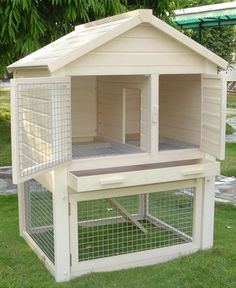 CUTE! But needs a floor on the bottom so it could be inside. (Huntington Townhouse Rabbit Hutch by NewAgePet)