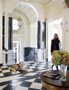 The foyer of this Back Bay mansion boasts original Italian marble floors and columns.