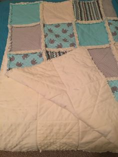 A personal favorite from my Etsy shop https://www.etsy.com/listing/265747374/baby-elephant-crib-rag-quilt