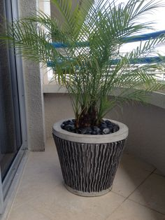 just one simple slate pot can make a small balcony space feel inviting
