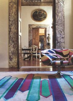 A view into the offices of the Emilio Pucci Company. The chair, 'Rive Droite', is made by Cappellini and the rug features the 'Nastri' motif.