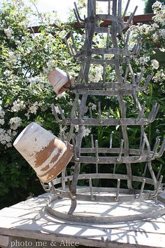 An old French bottle dryer works perfect for holding pots.