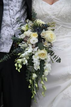 cascading bridal bouquet | form a gentle plume of loveliness in this cascade wedding bouquet ...