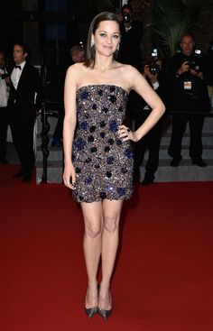 The actress sparkled in a Spring 2015 Dior Couture mini embellished with sequin florets. She completed her look with metallic pumps and diamond earrings.