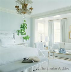 airy wall color Duck-egg blue and palest dove-grey in the cloud-like master bedroom are accentuated by soft white carpets and bedding, a Lucite Anne Coyle bench and vintage Bagues chandelier - Nate Berkus and Anne Coyle in Chicago All White Bedroom, Living Room White, Blue Bedroom, White Rooms, Bedroom Decor, Living Rooms, Bedroom Ideas, White Bedding, Dream Bedroom