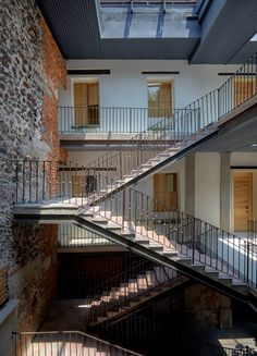 The studio has left behind some time-worn elements that hint at how long the building has been around – for example, the dramatic zigzag staircase that links together all the levels of the hotel backs onto a wall of crumbling bricks.