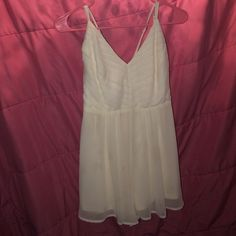 Ivory Dressy Romper w/ Strappy back I bought this from a local boutique called Steps and I bought for about $60, never worn and still has tag on it! It's size medium but will fit size small as well. It has a Strappy back and a detailed front. It is an ivory/cream color and is perfect for dresser events even though it is a romper. The Clothing Company Dresses