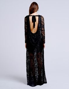 A black chiffon maxi dress with lace overlay and long sleeves.