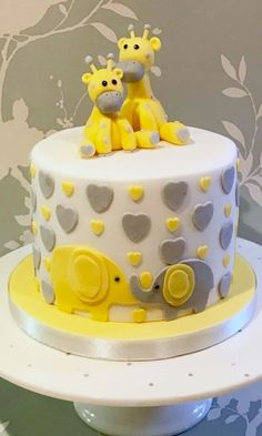 Giraffe christening cake, yellow and grey elephants