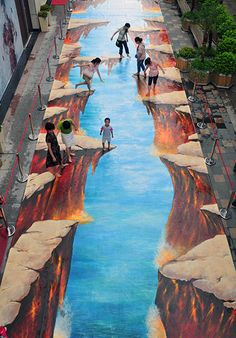 3D pavement art: 17 July 2011: People play on a 3D street painting at Wanda Square in Fuzhou