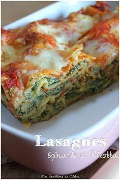 LASAGNES EPINARD-RICOTTA - 1 échalote - 1 gousse d'ail - 1 petit oignon - 10g de beurre - 280g de pousses d'épinards - 250g de ricotta - 1cs de parmesan - 1 oeuf - muscade, sel, poivre - 1 cs de jus de citron - 33 cl de coulis de tomate - 70g de tome de brebis ou mozzarella - 7/8 plaques de lasagne