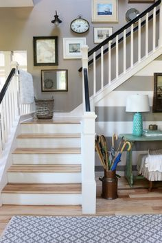 Black and White Staircase Railings with Hickory Floors - The Inspired Room Neutral Entry