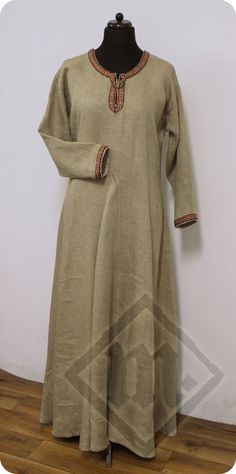 Viking basic dress made of twill linen (natural and beige). Decorated with woolen tablet-woven tapes around the neckline and cuffs.  Pieces were