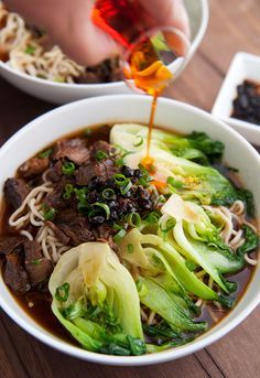 Taiwanese Beef Noodle Soup (牛肉麵) _ With beef shank, beef marrow bones, fermented bean curd, green onions, & baby bok choy. Place noodles in a bowl & top with beef shank, bok choy, & chopped green onions. Ladle the broth-sauce over the noodles. Drizzle some hot chili oil over top. This is the noodle soup of my people.