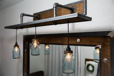 Rustic Industrial Light - Raw Steel & Barn Wood Vanity Light (Vintage Jar Shades) w/Bulbs #L1803 Specifications: - Overall Dimensions: 48 Wide x 16 Deep x 20 high (w/o bulb) - Shades: Vintage Jars (included) - Bulbs: 3 (included) - Bulb Type: Edison - 60 Watt - Max Wattage: 100 watts per socket - Socket: Black - These lights are dimmable with a wall dimmer switch - Fixture is fully assembled and ready for installation (bulbs are packaged separately) - Wall mounted directly in...
