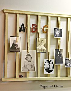 Re-Purposed Crib Rail Photo Display via OrganizedClutter.net....The lower left picture looks like one of Augie's young Brats!!