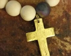 Stretchy beaded bracelet with gold cross charm - Edit Listing - Etsy