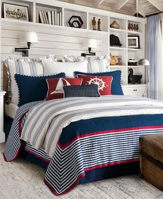 Dress your bedroom in nautical style with the Liberty Reversible Quilt Set from HiEnd Accents. This navy quilt set features navy, white and red striped trim with a coordinating reverse and pillow shams to complete the eye-catching look. Seaside Bedroom, Nautical Bedroom, Coastal Bedrooms, Coastal Bedding, Nautical Bedding Sets, Luxury Bedding, White Bedding, Patriotic Bedroom, Nautical Theme
