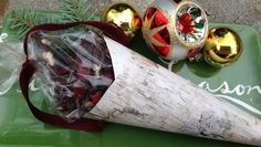 Cranberry-Pecan Dark Chocolate Bark with Candied Orange in a birchbark paper cone for gifting