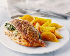 Spinach-Stuffed Chicken recipe - The spinach and cheese filling in these chicken breasts is so delicious you'll want to make it again and again! The spiced, crispy skin will help keep the meat tender and juicy. Chicken Skillet Recipes, Grilled Chicken Recipes, Healthy Diet Tips, Healthy Recipes, Savoury Recipes, Healthy Food, Chicken Cutlets, Chicken Breasts, Spinach And Cheese