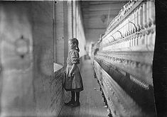 This young girl at that same mill staring out a window. She had already worked there more than a year.