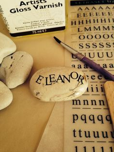 How to make name stones. A lovely simple nature craft idea for kids that they can being indoors. Great thrifty gift idea too