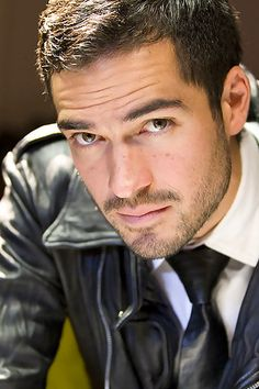 Alfonso Herrera - Not going by the book description, in my mind, this is Riaz Delgado, a Wolf Changeling and a Lieutenant of the SnowDancer wolf pack from Nalini Singh's Psy-Changeling series. (Tangle of Need)