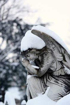 Praying Angel in the Snow - Mount Jerome cemetery, Dublin