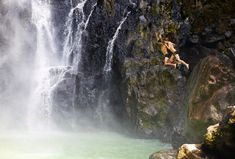 Two people jump into the pool at the foot of Victoria Falls © Nick Ledger / Getty Images
