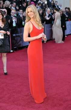 At age 20, J.Law was nominated for an Academy Award for her breakout role in Winter's Bone. �She looked stunning on the red carpet in this vibrant Calvin Klein gown. via StyleList