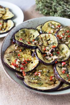 Easy Italian marinated eggplant recipe- grilled eggplant/aubergine marinated in garlic, oregano, chili and mint. Perfect as a side, with salad or as an antipasto with drinks. So easy, you'll love it, inside the rustic kitchen.