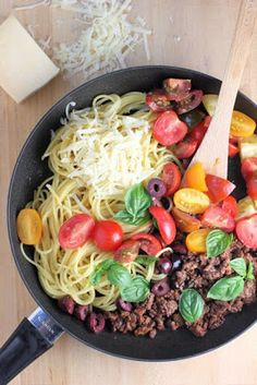 A hearty summer pasta with ground beef, fresh tomatoes and herbs, olives, and Parmesan cheese.  #spaghetti #beef #tomatoes