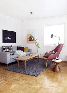 Grey sofa & raspberry lounge chair in living room