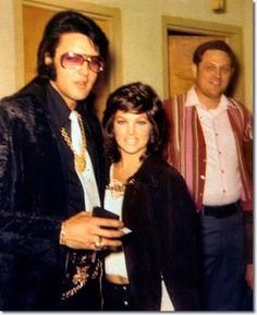 Elvis and Priscilla, December 29, 1970. Elvis receives another badge.