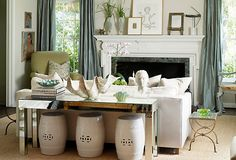 living rooms - mirrored console table white garden stools shell bowl white sofa French brass side table fireplace blue silk drapes sisal rug on imgfave My Living Room, Living Room Decor, Living Area, Small Living, Modern Living, Bedroom Decor, Table Behind Couch, Couch Table, Blue Curtains