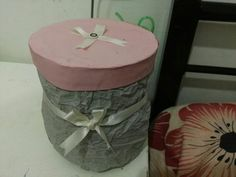 Diy craft storage box Method: Cut out the top of a 5 gallon water  bottle  Cover the bottle bottom with any fancy paper or cloth  Cut out a lid of the same size using cardboard Take a milk bottle and cut into strips, attach the strip to the cardboard like a lid n tape it Then cover the whole thing with a fancy paper , color it or decorate it  Uses: You can store ur craft supplies , socks or inner garments . It takes less space n easily accessible.