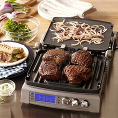Cuisinart Elite Griddler ★                     Cuisinart Elite Griddler George Foreman just got knocked the F out. The Cuisinart Elite Griddler is just a leaner, meaner cooking machine. The 3-way design allows for pressing, grilling and griddling all with easy adjustments and mess-free nonstick surfaces.