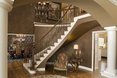 The finish appears to be Venetian Plaster, and the color is similar to Benjamin Moore's Plymouth Brown. The trim is similar to Benjamin Moore's Snow White. || The same look can easily be a achieved with Ralph Lauren Suede paint.