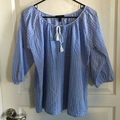 J Crew Peasant Top Size XS Peasant top with 3/4 sleeves and tassel tie in the front. Color is light blue with white dots. Material is slightly puckered and is 99% cotton and 1% Lycra. Has a loose, oversized fit that is perfect for the hot summers. Only worn a few times. No trades or Paypal. J. Crew Tops Blouses