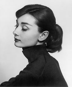 Audrey Hepburn. The black turtle neck, skinny pants and flat shoes.