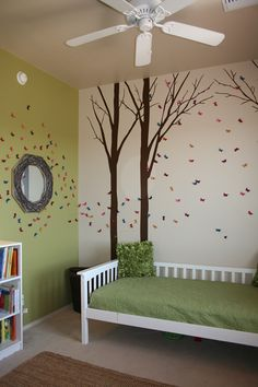 There's something about an enchanted forest that imparts a world of possibility. Whether your child is bewitched by fairies, enamored by fables, or simply loves the great outdoors, a room with towering trees and butterfly wall art makes for a magical space. Opt for grassy green bedding for a look your kid won't soon outgrow. See more at Such the Spot »  - GoodHousekeeping.com