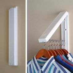 The InstaHANGER Laundry Room Organizer stays flat against the wall out of the way when not in use and folds out to provide 12 inches of hanging space