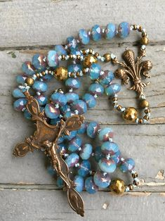 Bohemian Czech Bead Rosary with Bronze Fleur De Lis Centerpiece and Crucifix Hand Knotted by SeeJanesBeads by SeeJanesBeads on Etsy I call my Rosaries Rosary Bracelet, Rosary Beads, Beaded Bracelets, Prayer Beads, Catholic Jewelry, Rosary Catholic, Do It Yourself Inspiration, First Communion Gifts, Holy Rosary
