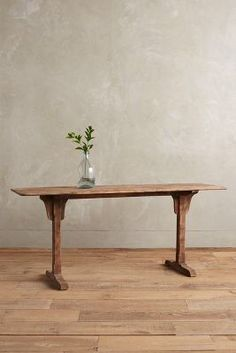 Anthropologie Burnished Wood Console https://www.anthropologie.com/shop/burnished-wood-console?cm_mmc=userselection-_-product-_-share-_-C34338269