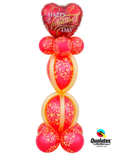 This column looks opulent with its red and gold balloons and embellished Microfoil heart. #qualatex #balloon #heart #red #gold #valentines