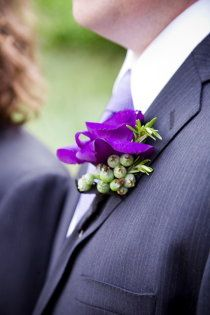 This with green hypericum berries; Purple boutonniere